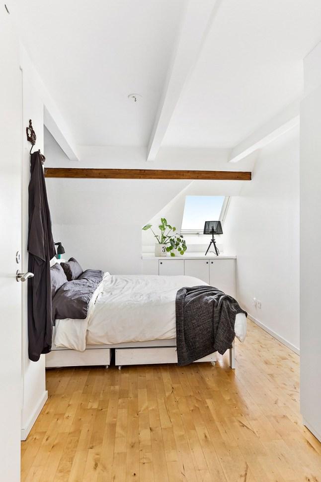 Appartement sous combles avec poutres apparentes