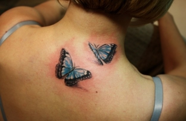 Awesome Black And Blue Color Ink Pretty Blue 3D Butterflies Tattoos On Girl's Back