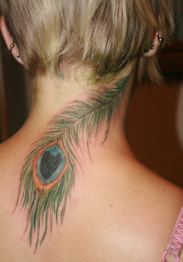 Awesome Green Ink Peacock Feather Tattoo Design On Women Nape Or Neck