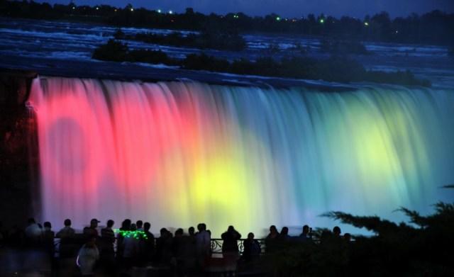 Awesome Colorful Niagara Falls And People Enjoying The Night View Of Niagara Falls