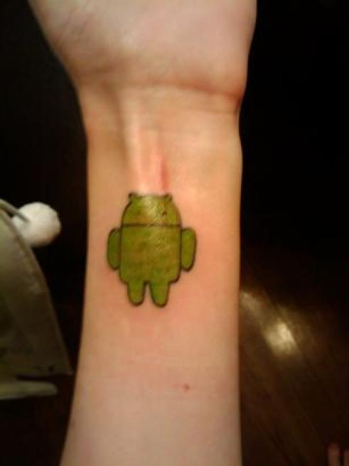 Coolest Android Green Ink Small Tattoo Design Made On Men Arm Or Wrist