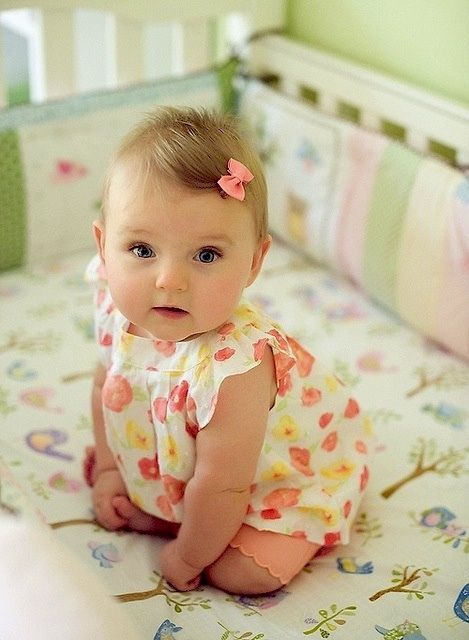Cute Girl Baby Sitting On Bed