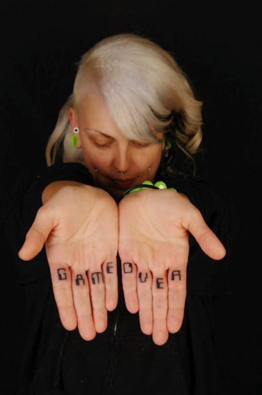 Funny Game Over Finger Tattoo Design For Cool Women
