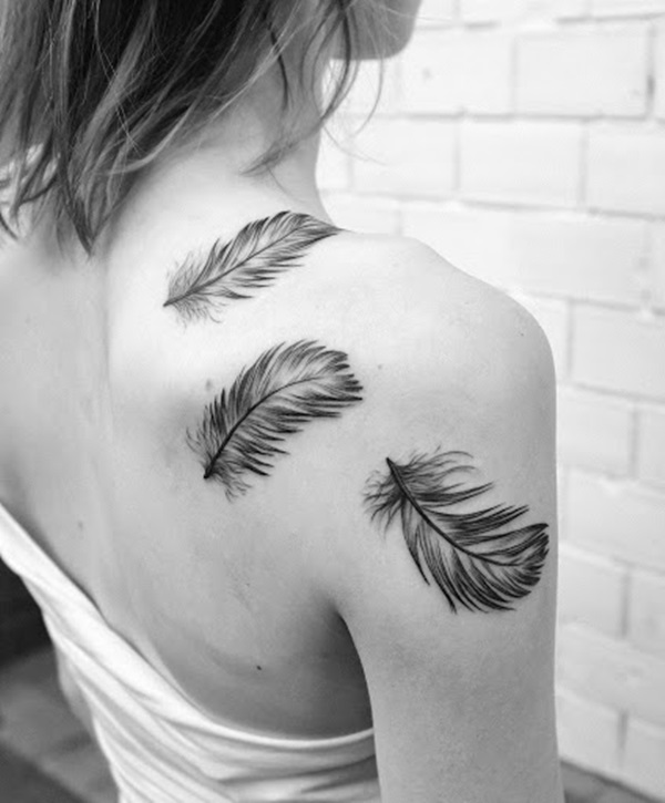 Girl Back Decorated With Amazing Grey Ink Bird Feather Tattoo