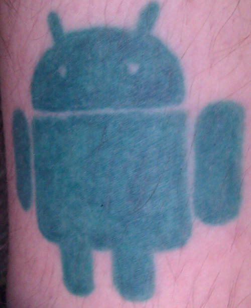 Huge Logo Of Android Tattoo Design