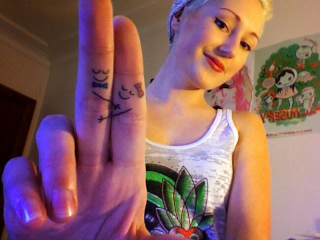 Iggy Azalea With Smiling Couple Finger Tattoo Design