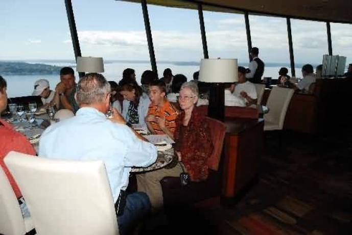 Many People In Restaurant Space Needle Inside Photo
