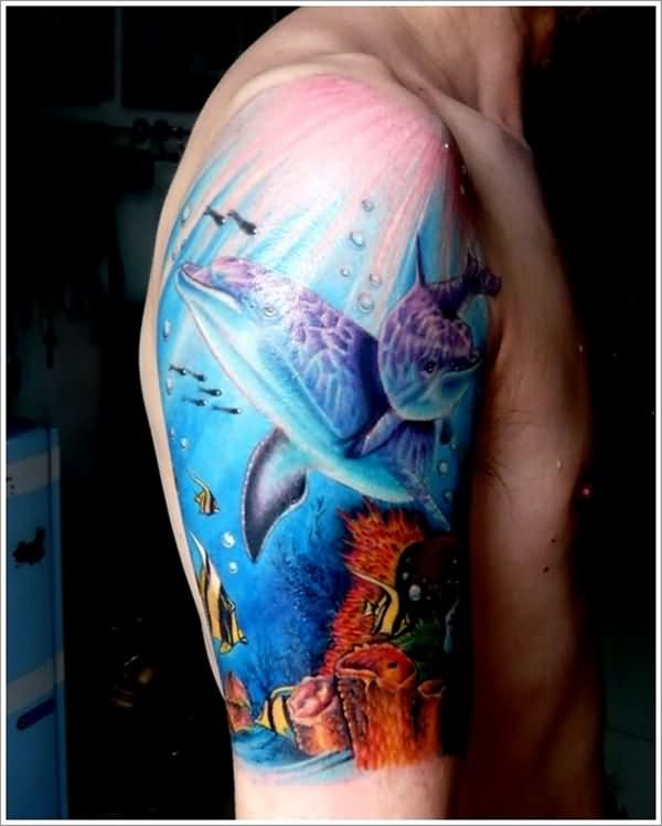 Nice Aqua Sea Dolphin Underwater Tattoo On Men Shoulder