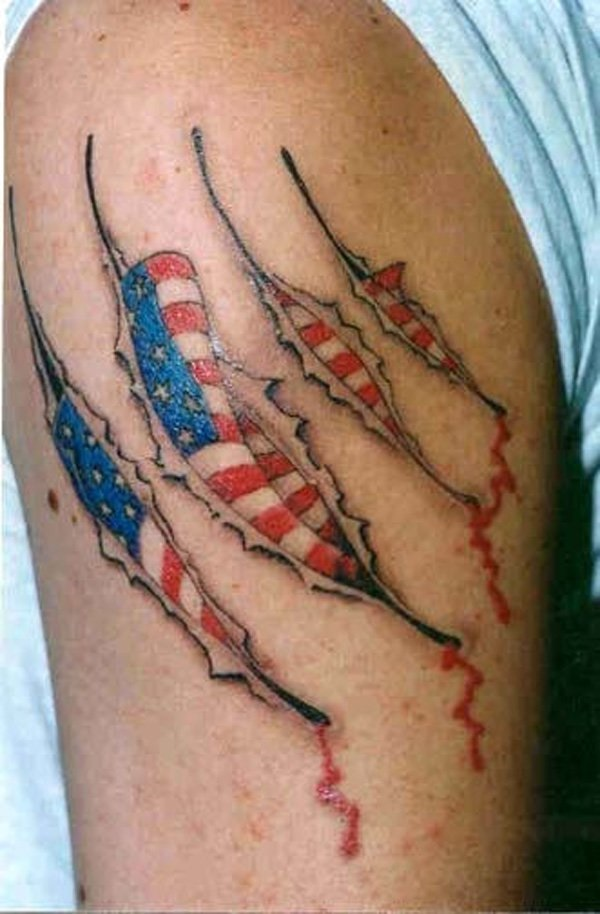 Nice Ripped Skin American Flag Tattoo For Men Upper Arm