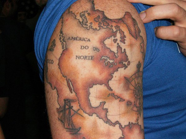 Old World Map Tattoo With Colourful Ink On Arm For Man Woman