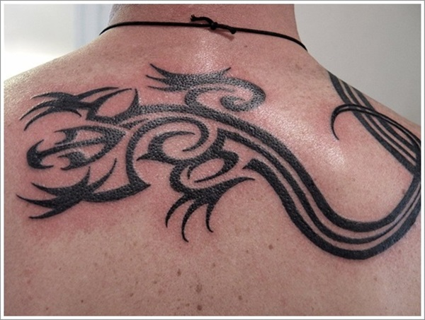 Outstanding Black Ink Tribal Lizard Tattoo Design For Men Upper Back Or Nape