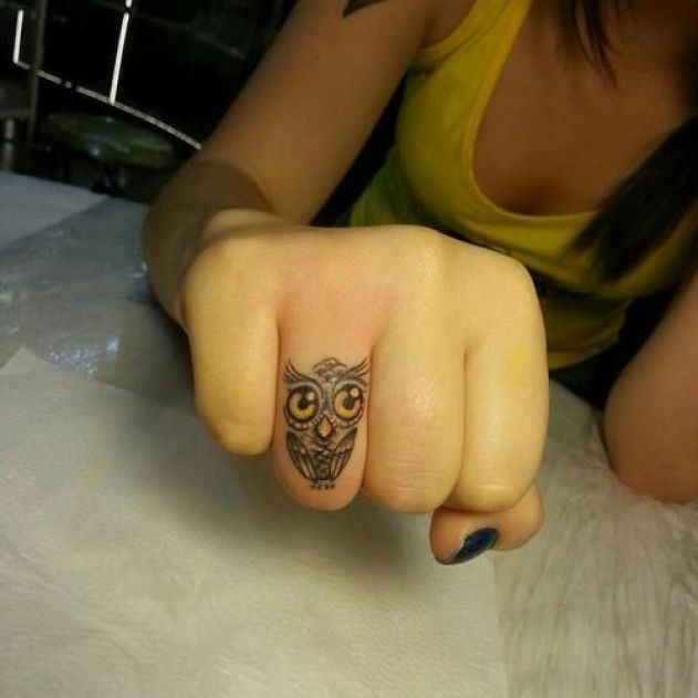 Outstanding Grey Ink Small Baby Owl Face Tattoo Design For Girl Ring Finger