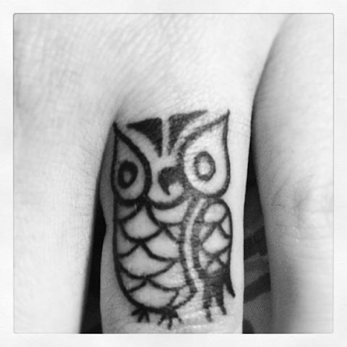 Simple Black Ink Cute Baby Owl Tattoo Design For Middle Finger
