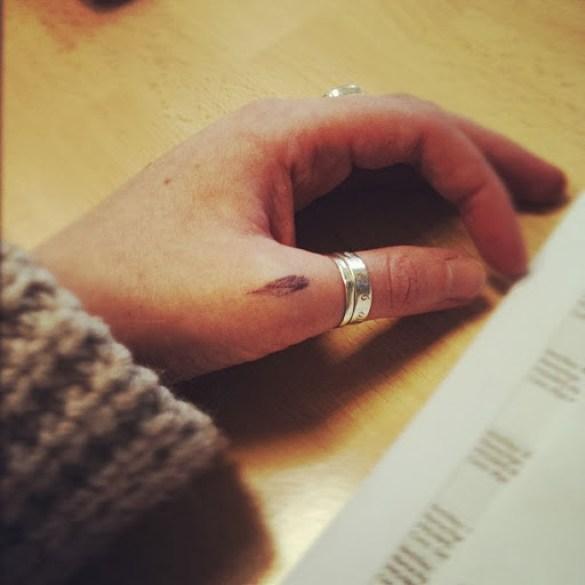 Small Black Ink Finger Tattoo Design For Women Thumb