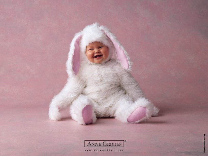 Smiling Baby Wearing Bunny Dress