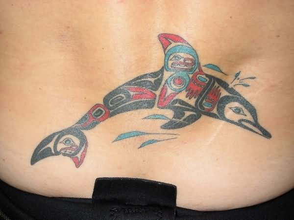Wonderful Tribal Dolphin Tattoo Idea For Women Lower Back