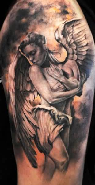 adorabel gray color ink Angel Tattoos on boy shoulder made by expert artist for boys