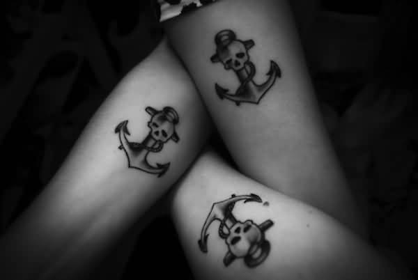 adorable black color ink scary anchor tattoo on three boy sleeve for boys made by expert