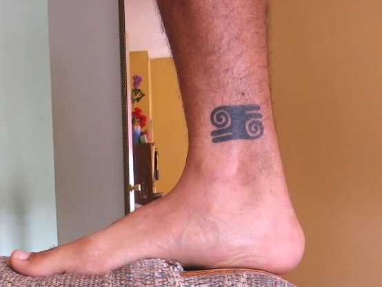 Adorable Gray Color Ink African Kwatakye Atiko Symbol Tattoo For Man