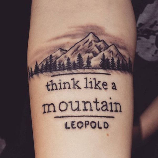 amazing forest and mountain tattoo on wrist With Black ink For Man And Woman