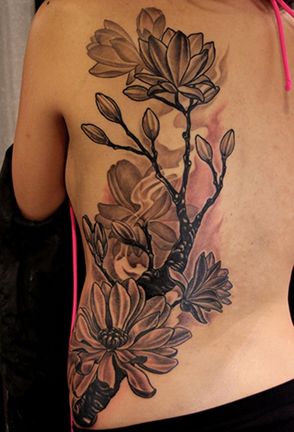 attractive Magnolia black and white tattoo on side With colourful ink For Man And Woman