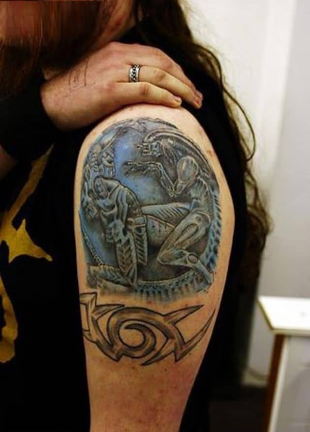 attractive blue color ink Predator Tattoo On Shoulder made by expert
