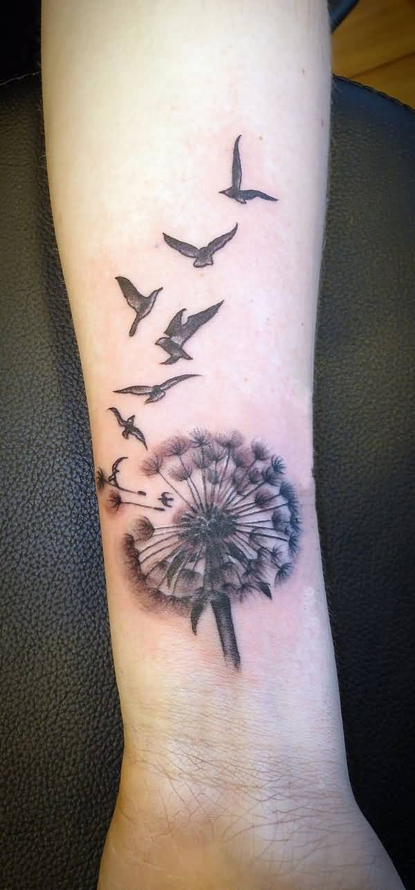 awesome Dandelion Tattoos on wrist With Black ink For Man And Woman