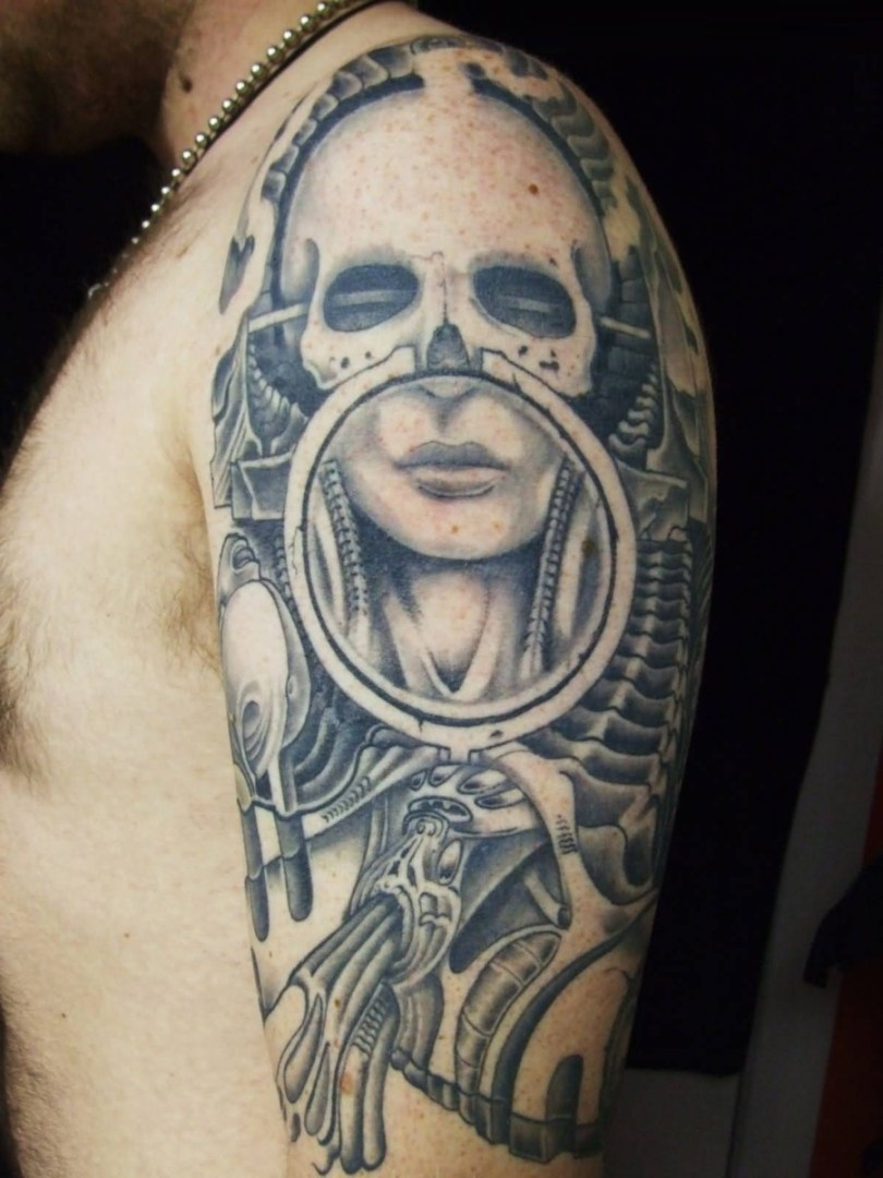 Awesome Gray Color Ink Alien Face Tattoo On Shoulder For Man