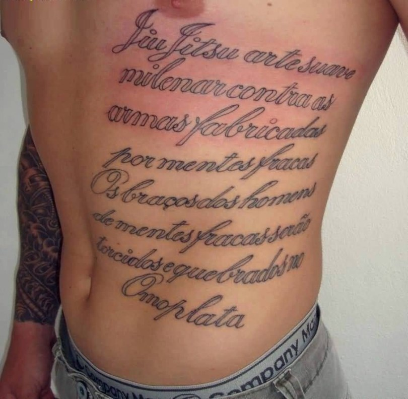 awesome gray color ink rib tattoo of ambigram text for boys