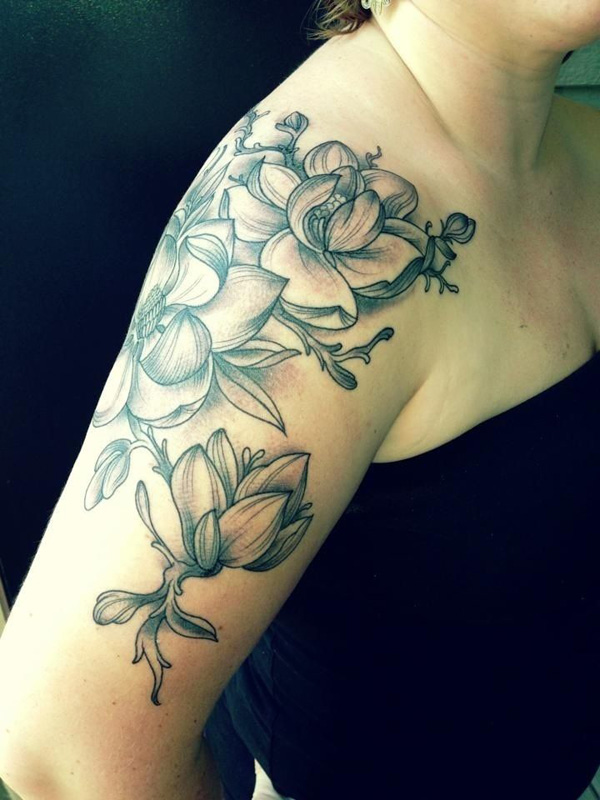 awesome magnolia flower half sleeve tattoo on arm With black ink For Man And Woman