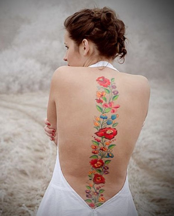 Beautiful Flowers Spine Tattoo With Colourful Ink For Woman