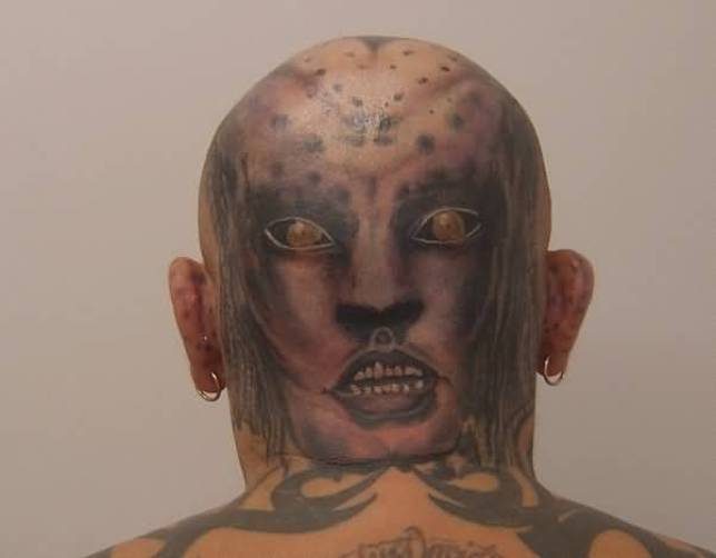 Beautiful Scary Alien Head Tattoo On Backside Of Mans Head Made For Man