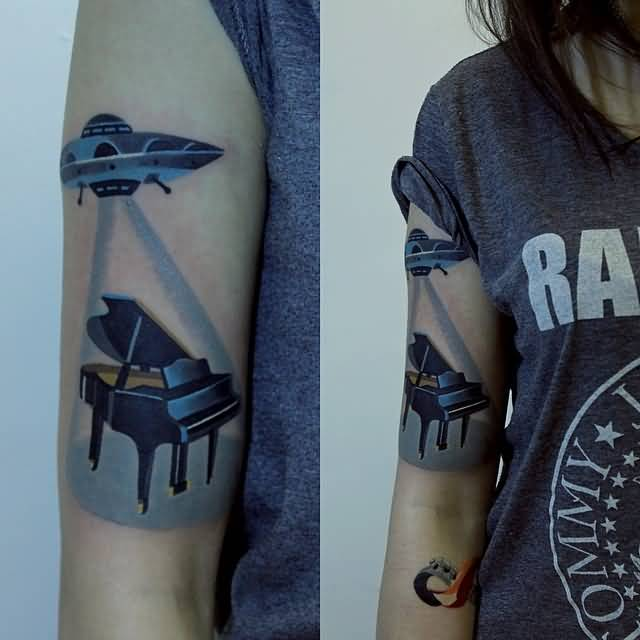 brriliant blue color ink Funny Ufo And Piano Tattoo made by expert