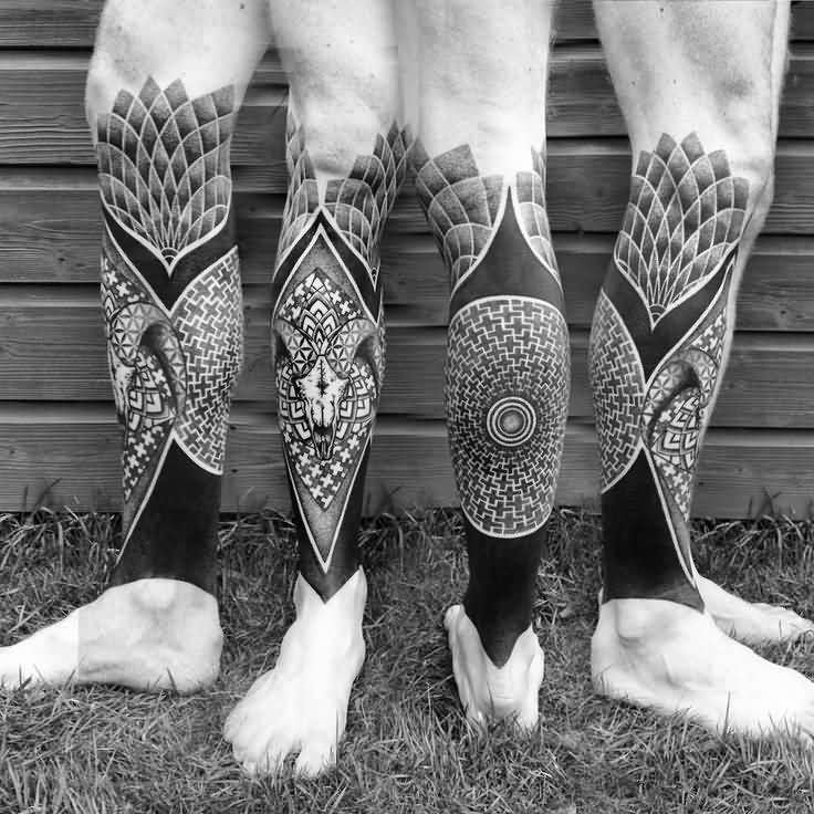 Charming Black Color Ink On Leg African Tattoo