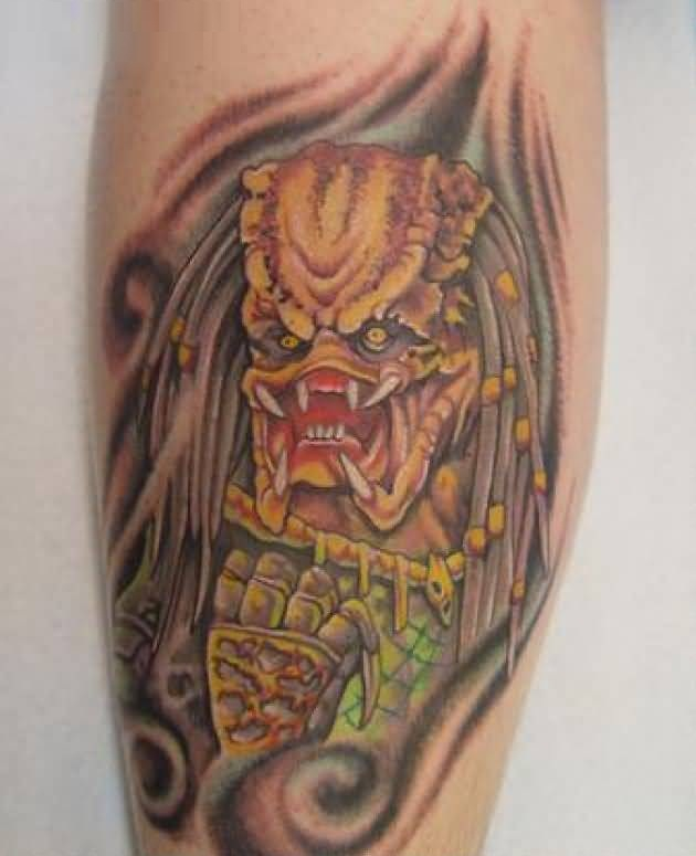 Charming Yellow Color Iink Scary Predator Tattoo On Mans Calf For Man