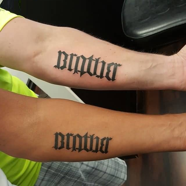 creative black color ink ambigram tattoo made by expert for boys only