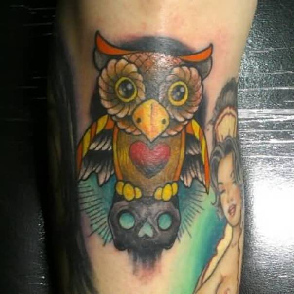 creative yellow red and black color ink animated owl tattoo on boy's sleeve for boys only made by expert
