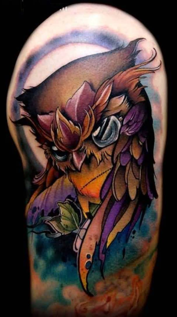 custom red light blue and black color ink animated owl tattoo on girl's shoulder for girls only made by expert