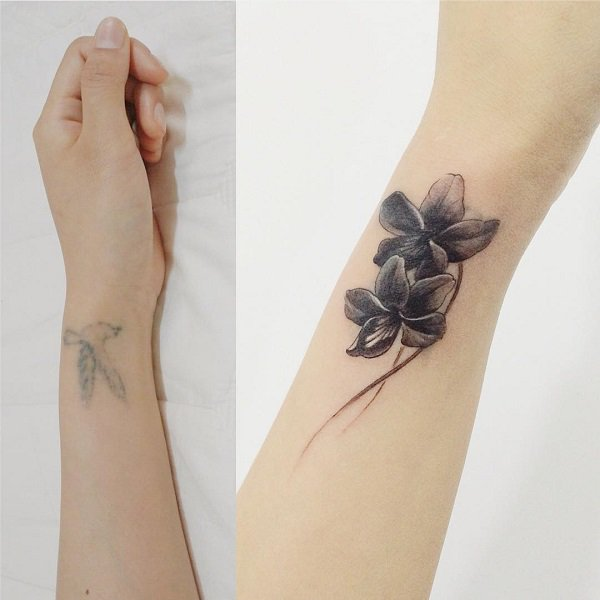 Cute Flower Wrist Cover Up Tattoo On Wrist With Black Ink For Man And Woman