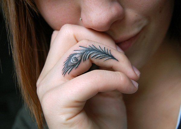 Cute Peacock Finger Tattoo With Black Ink For Man And Woman