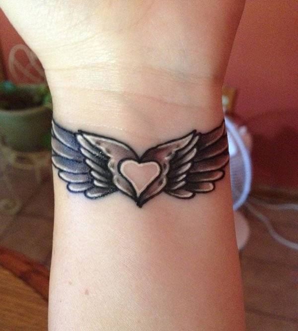 Cute Wing Wrist Tattoo With Black Ink For Man Woman