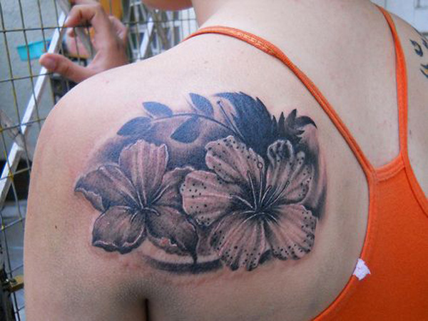 dashing Hibiscus tattoo on back With colourful ink For Man And Woman
