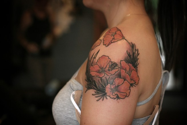 dashing Poppy Tattoo on Shoulder With colourful ink For Man And Woman (2)