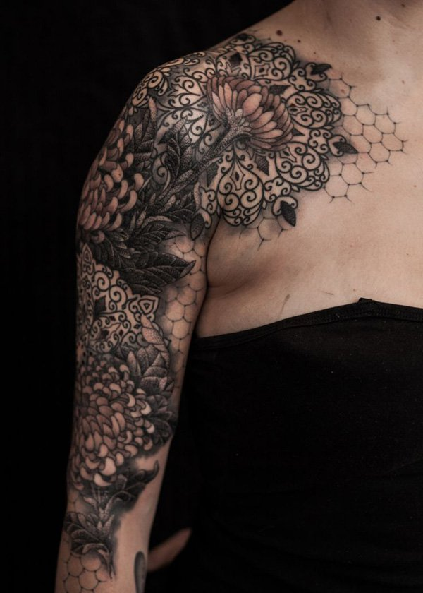 dashing chrysanthemum tattoo on chest With black ink For Man And Woma