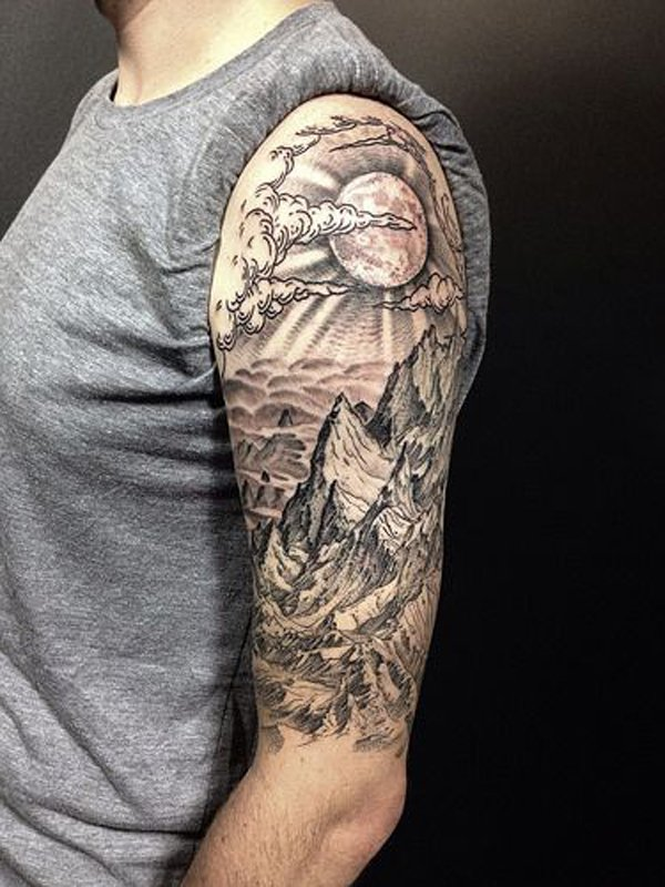 dashing mountain tattoo on arm With Black ink For Man And Woman