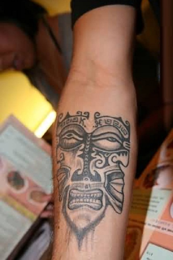 Elegant Old Mask Tatto Of Africaon Arm For Man