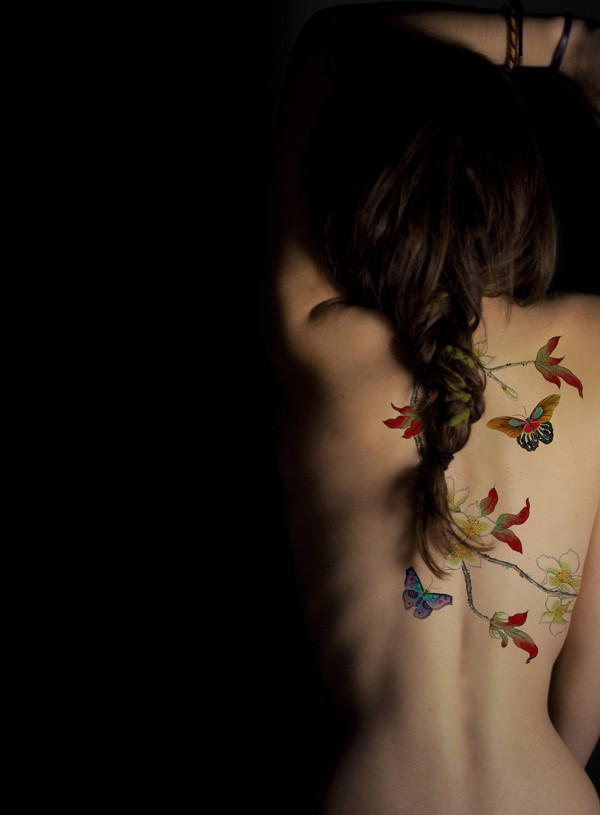 Incredible Butterfly Colour Tattoo On Back With Colorful Ink For Man Woman