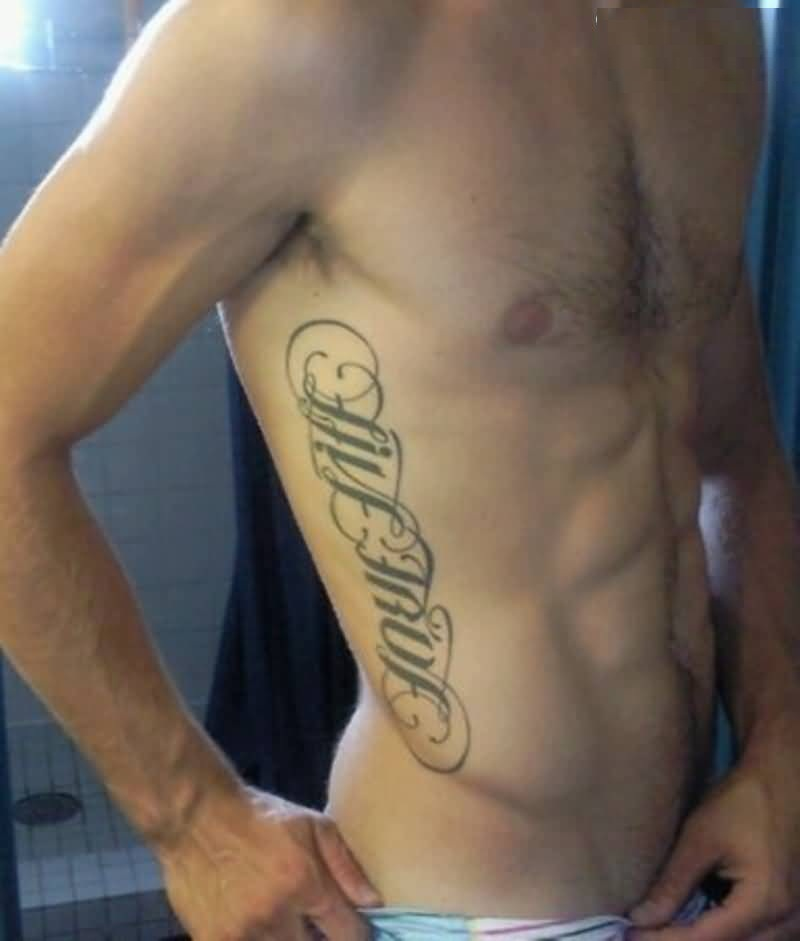 extermely gray color ink tattoo on ambigram text for boys rib