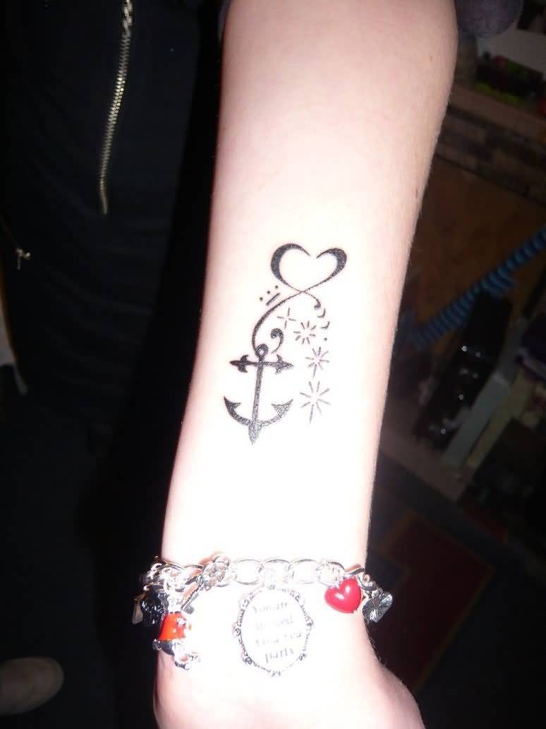 extremely black color ink anchor tattoo on girl arm for girls made by expert