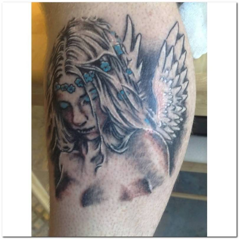 fabulous gray and blue color ink Angel Tattoos on girl 's leg for girls made by expert